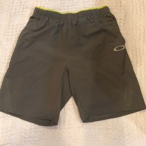 Oakley board shorts built in briefs. Size medium.